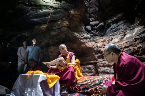 His Holiness the Dalai Lama reciting a Buddhist text at the Chaanda Devi Caves where the Indian philosopher Nagarjuna meditated in Sirpur, Chattisgarh, India on January 14, 2014