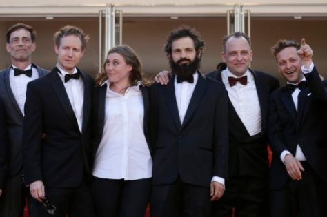 From left, actor Todd Charmont, director Laszlo Nemes, screenwriter Clara Royer, actors Geza Rohrig, Urs Rechn, and Levente Molnar pose for photographers as they arrive for the screening of the film Saul Fia (Son of Saul) at the 68th international film festival, Cannes, southern France, Friday, May 15, 2015. (AP Photo/Lionel Cironneau)