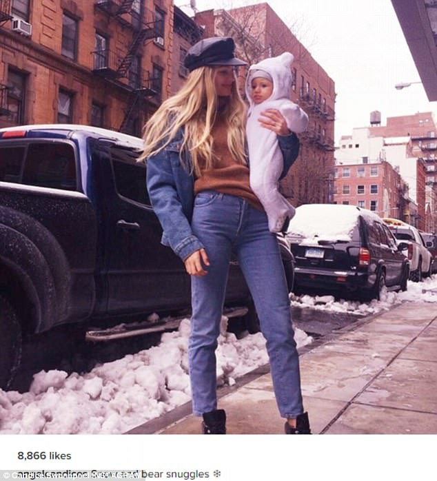 'Snow and bear snuggles': Victoria's Secret model Candice Swanepoel poses with baby Anacã in post-storm New York City