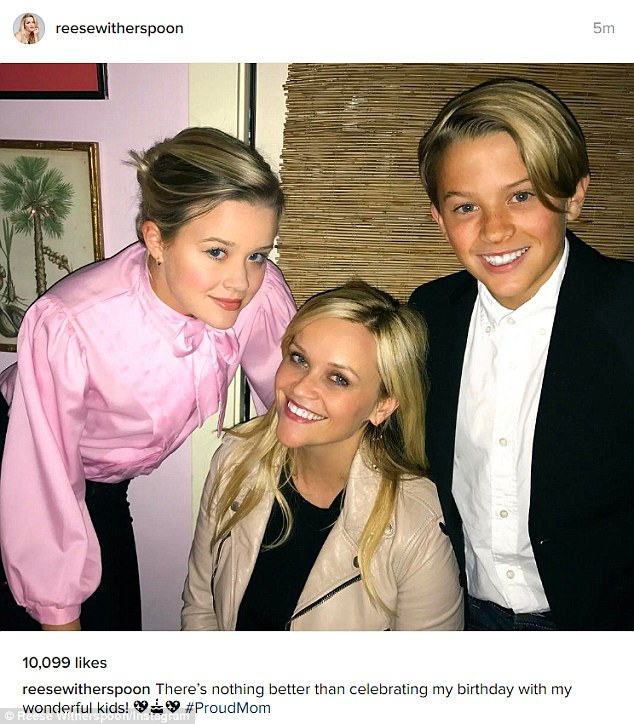 Reese Witherspoon shows off her youthful complexion as she poses for birthday photo with children Ava and Deacon