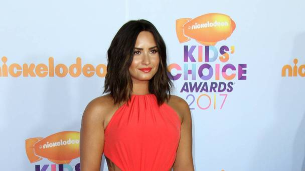 Demi Lovato: 'I'm not nude in leaked photos!'