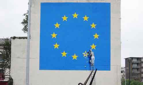 Banksy Brexit mural of man chipping away at EU flag appears in Dover