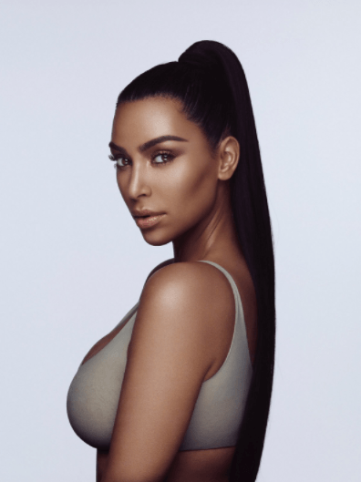Kim Kardashian hits back after she is accused of darkening her skin tone in advert for new make-up range