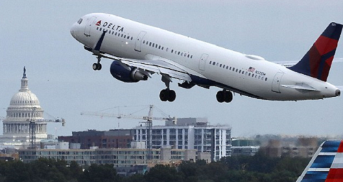 Passengers arrested after performing oral sex while they were in their seats on Delta flight