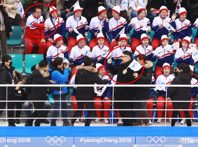 A Kim Jong Un impersonator walked through North Korea's Olympic cheer squad — and their faces say it all